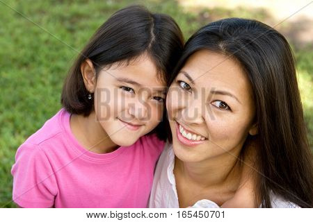 Portrait of an Asian mother and her daughter.