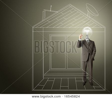 Businessman With Lamp-head And Marker In House