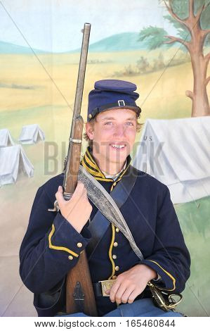JULY 24, 2015. CASPER, WYOMING. CIRCA: Young calvary reenactor military male recruit posing for the camera outdoors at the annual pioneer day in Casper.