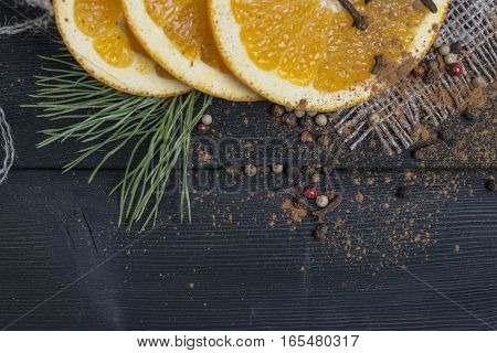 orange fruit with spices on wooden table background