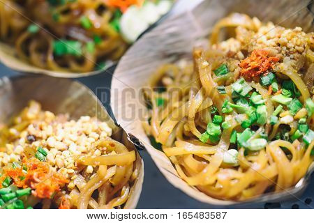 Padthai stir fried rice noodles with shrimp in dried banana leaves