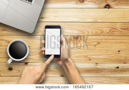 Hand Using Phone Laptop And Coffee Cup On Wood