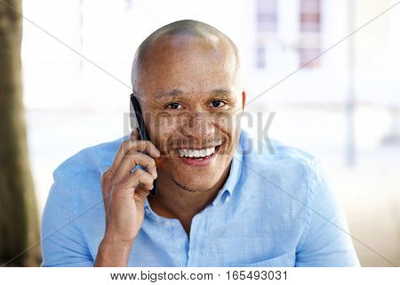 Close Up Smiling African Businessman Talking On Cellphone