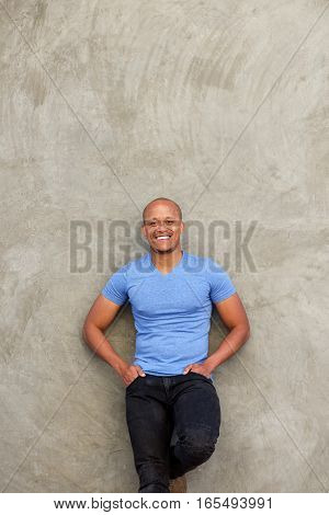 Cool Black Guy Leaning Against Wall And Smiling