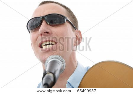 a young handsome man singing with microphone
