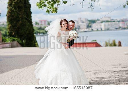 Laughs Wedding Couple Hugging Background Large City Lake.
