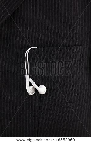 Earbud type headphones in the pocket of suit jacket