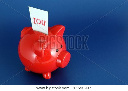 IOU card in piggy bank signifying debt or financial problems