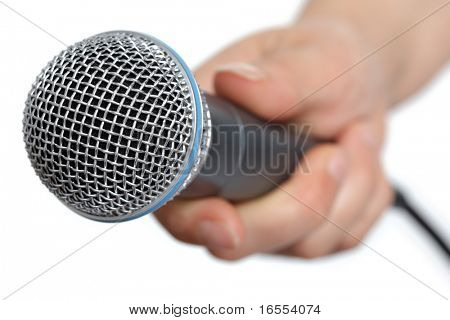 Womans hand holding a microphone conducting an interview
