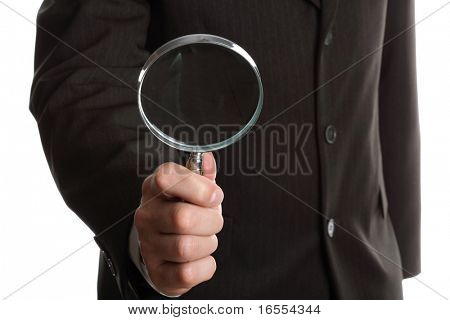 Hand of a businessman holding a magnifying glass on white background