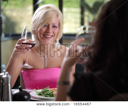 Friends enjoying a meal and cheerful discussion at a restaurant