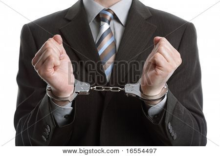 Corporate crime concept, businessman wearing handcuffs