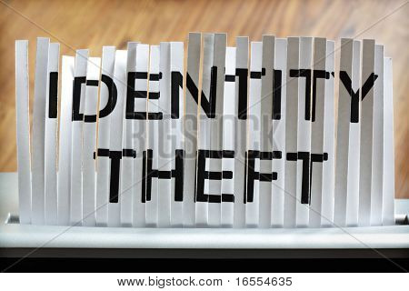 Identity theft concept, shredding personal information