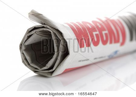 Rolled up newspaper on white background