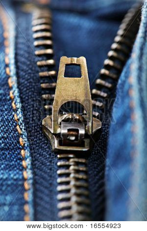 Close up of a zip on a pair of blue jeans half unzipped