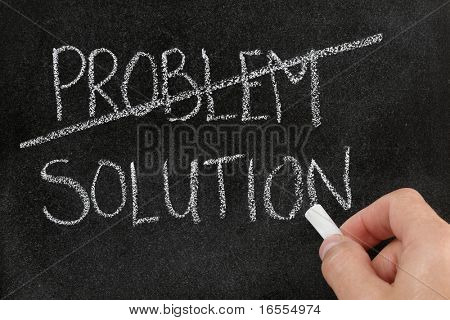 Crossing out the word problem and writing solution on blackboard