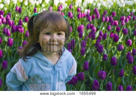 Happy Girl In Tulips