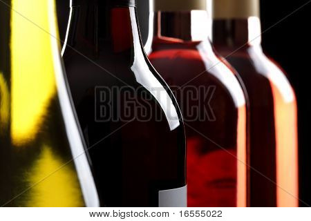 Red white and ros? wine bottles in a row
