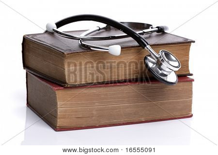 Stethoscope on old hardback books concept for medical research or ethic