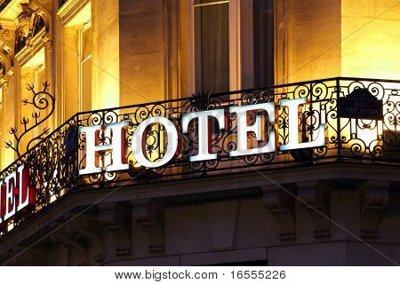 Illuminated hotel sign taken at dusk