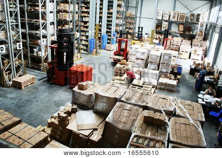 Full warehouse with forklifts and lots of packages