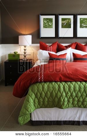 Modern, warm, inviting bedroom or hotel room.