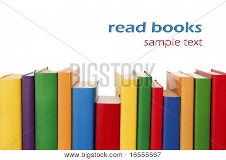 Many colorful books in a row creating a border frame. Isolated on white.