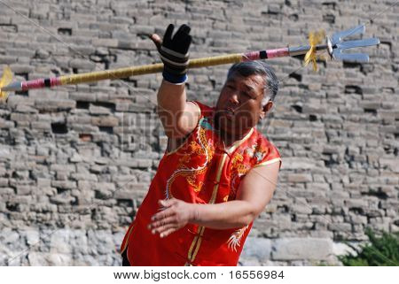 BEIJING - APRIL 12: an old man was performing a kind of Chinese ancient weapon in Ming rampart park of Beijing.