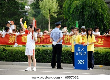 Inner Mongolia,China - JULY 10:  A torch bearer during the olympic torch relay for the Beijing 2008 olympic games (August 8, 2008) in Inner Mongolia, China on July 10.