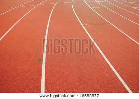 Red racetrack with white lines