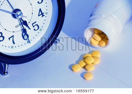 alarm clock and pills,concept image.