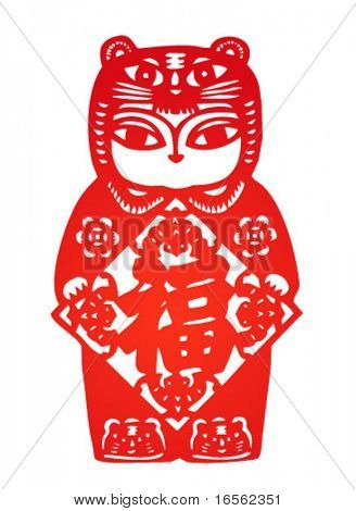Traditional chinese paper-cut,girl with tiger headwear celebrating chinese new year.