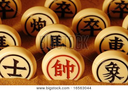 Rows of traditional chinese chess on sands