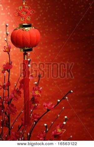 Chinese new year decoration--Red lantern and Siverbud willow on a festive background.