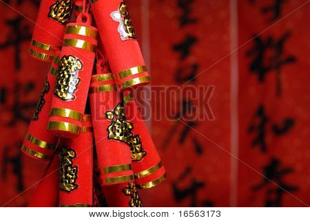 Closeup of artificial firecrackers with a festive background.