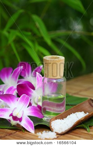 Spa still life with orchid flower,sea salt and essential oil,Closeup.