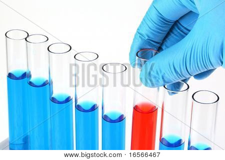 Scientist holding red test tube from test tube rack,Concept.
