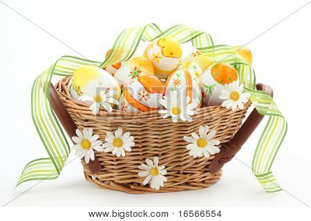 Basket full of easter eggs and spring flower