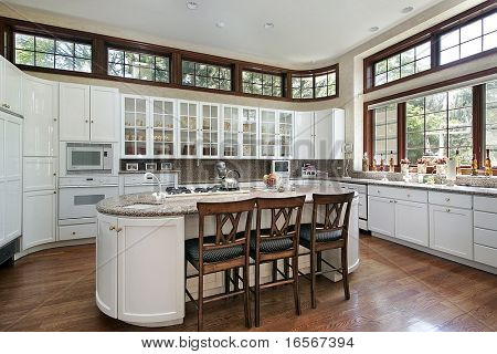 Kitchen with island and glass cabinets
