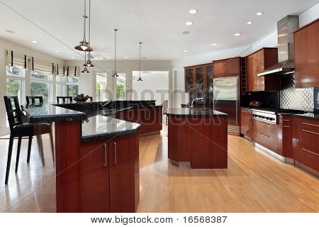 Modern kitchen in luxury home with dark gray granite counters