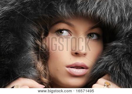 Beautiful woman. Winter fashion & makeup