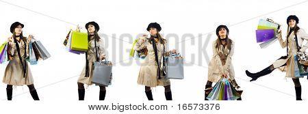 Retrato de belas moças com seus sacos de compras. Isolado no fundo branco