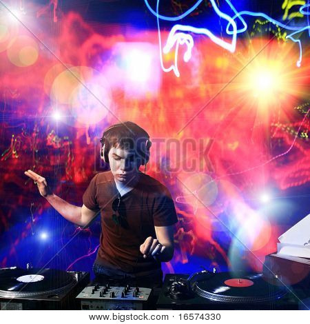 Dj playing disco house progressive electro music at the concert