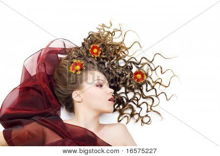 Portrait of the beautiful woman with long curly hair and flowers. Isolated