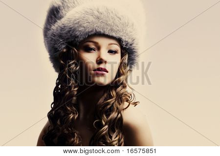 portrait of a beautiful lady in fur cap