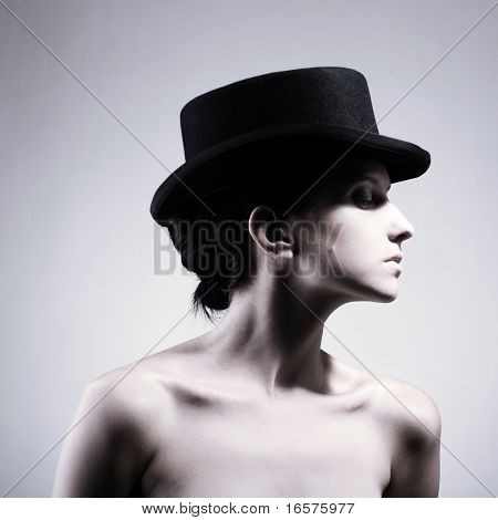 Beautiful young model in hat. Contrast photo