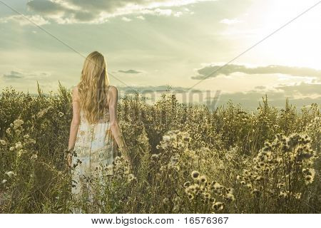 Portrait of beautiful girl in field