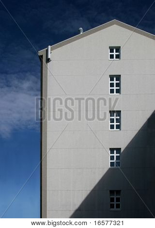 Large apartment building against a blue sky