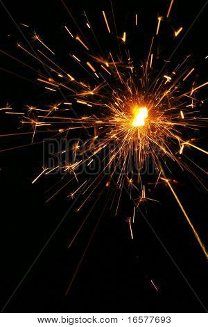 Firecracker exploding with sparks flying