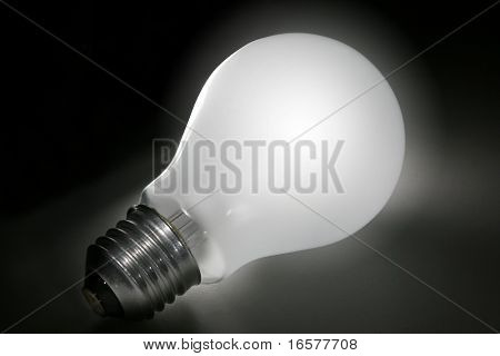 Lightbulb illuminated on a dark background with clipping path
